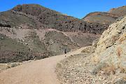 Woman walking in Cabo de Gata national park, Monsul, near San José, Almeria, Spain