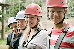 four teenagers in a climbing crag, close-up