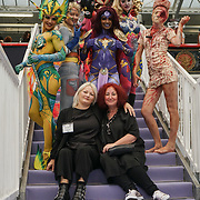 Olympia London, London, England, UK. Body paints and at the front is Nicci Jackson is the Head Judge (L) & Julia Townend body painting Judge (R) of Comic Strip Couture Body Painting Competition, at The Olympia Beauty show at Kensington Olympia in London on 1st October 2017.