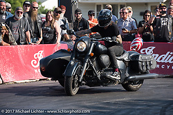 An Indian Chief with a sidecar was part of the stunting performance at the Indian footprint during the annual Sturgis Black Hills Motorcycle Rally. SD, USA. Saturday August 12, 2017.  Photography ©2017 Michael Lichter.