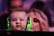 CORRECTION Daryl Gurney's baby boy with ear defenders with his mum during the Darts World Championship 2018 at Alexandra Palace, London, United Kingdom on 18 December 2018.