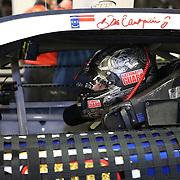 Racecar driver Dale Earnhardt Jr. is seen in his car during the  56th Annual NASCAR Daytona 500 practice session at Daytona International Speedway on Wednesday, February 19, 2014 in Daytona Beach, Florida.  (AP Photo/Alex Menendez)