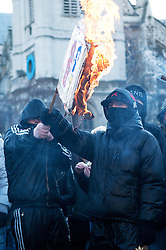 FILE PICTURE - Roundup of yesterdays Student protests..© under license to London News Pictures.  09/12/2010. Masked students burn placards in Parliament Square in London. Photo credit should read Michael Graae/London News Pictures