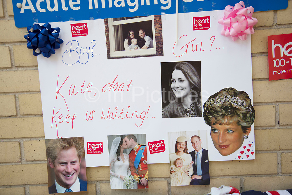London, UK. Thursday 23rd April 2015. Royalists gather opposite the Lindo Wing of St Mary's Hospital, where Kate Middleton, Duchess of Cambridge is due to give birth to her second child. Proud to be dressed in Union Jack flags for birth of the latest Royal baby.