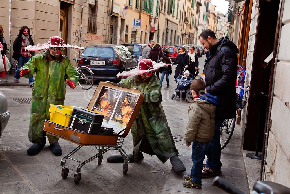 Clowns on the street in Florence selling tickets for a children's show