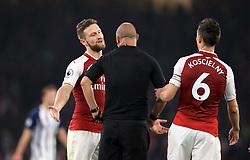 Arsenal's Shkodran Mustafi speaks with referee Robert Madley