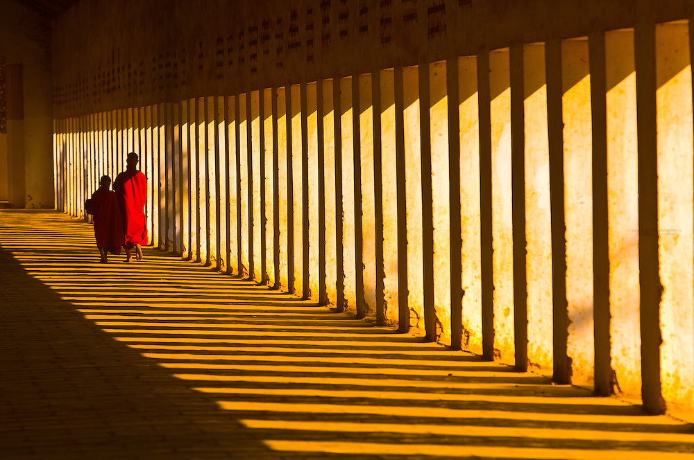 Monks walking down hallway in the Shwezigon Pagoda, Bagan, Myanmar (Burma)