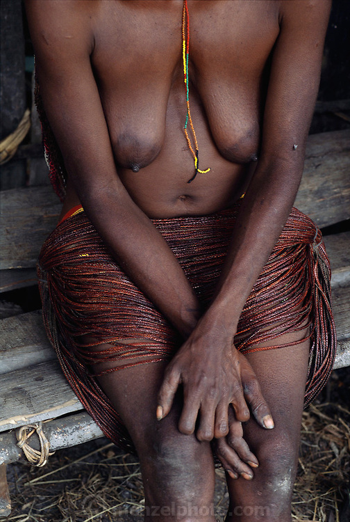 Amuloke Walelo, a Dani tribeswoman from Soroba village in the Baliem Highlands of central Irian Jaya, Indonesia. Four fingers of her left hand were severed when she was five years old as a tribute to family members who die. Image from the book project Man Eating Bugs: The Art and Science of Eating Insects.