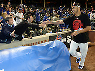 CHICAGO, IL - OCTOBER 12:  Hector Rondon #56 of the Chicago Cubs celebrates with fans after Game 3 of the NLDS against the St. Louis Cardinals at Wrigley Field on Monday, October 12, 2015 in Chicago , Illinois. (Photo by Ron Vesely/MLB Photos via Getty Images) *** Local Caption *** Hector Rondon