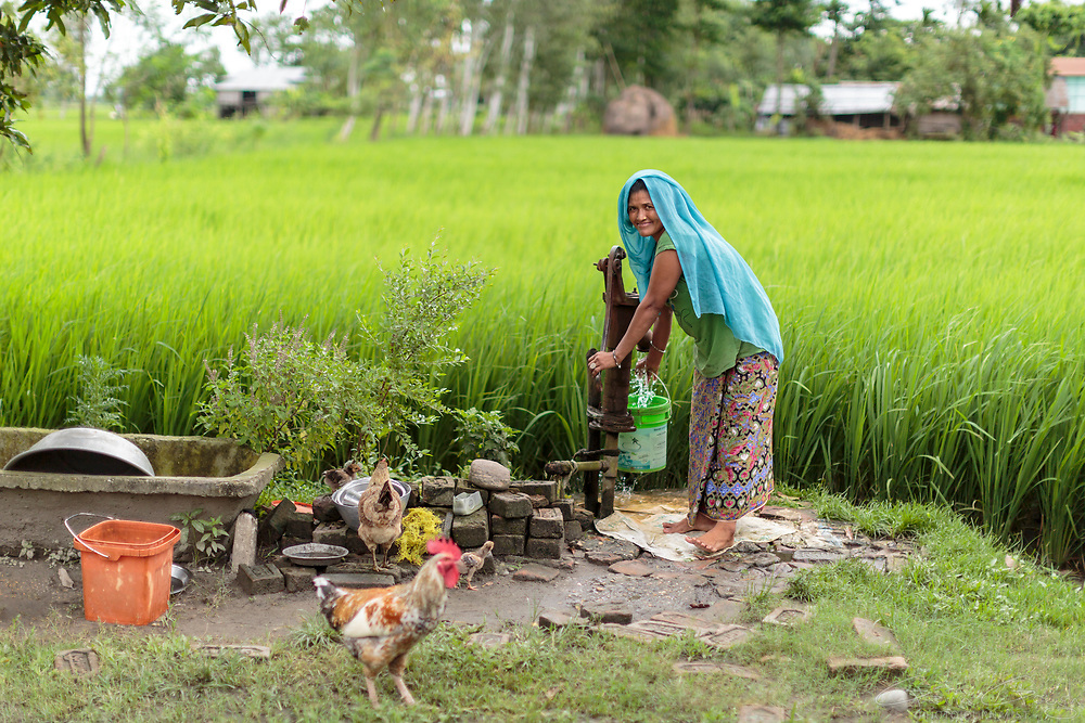 Muna Thapa collects water from a ground source water pump outside her village home. This water has not been treated and whilst it can be used for irrigtaion, it may not be safe to drink. However, it does provide a source of water that Muna can put into the biosand filter.