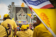 05 DECEMBER 2012 - BANGKOK, THAILAND:  People on the Royal Plaza watch Bhumibol Adulyadej, the King of Thailand, on CCTV during his public audience from the Mukkhadej balcony of the Ananta Samakhom Throne Hall. December 5 is a national holiday. It's also celebrated as Father's Day. Celebrations are being held across the country to mark the birthday of Bhumibol Adulyadej, the King of Thailand.   PHOTO BY JACK KURTZ