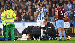 Huddersfield Town's Chris Lowe receives medical attention during the Premier League match at the John Smith's Stadium, Huddersfield.