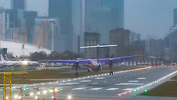 """**NB VIDEO FRAME GRABS**<br /> Strong crosswinds at London City Airport have caused passengers to be subjected rough landings where the aircraft approach the runway flying almost sideways, whilst several flights had to abort landings and perform a """"Go-Around"""" as Storm Erik grips the United kingdom. London, February 08 2019."""