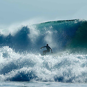 Big sets coming in at Desert Point, Lombok, Indonesia attracting some of the worlds best surfers to this remote surf spot.