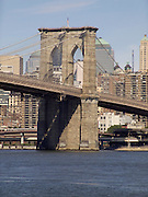 View of the Brooklyn Bridge pillar with the downtown Manhattan in the background