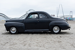 A hotrod sits in the sand after TROG (The Race Of Gentlemen). Wildwood, NJ. USA. Sunday June 10, 2018. Photography ©2018 Michael Lichter.