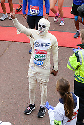 © Licensed to London News Pictures. 28/04/2019. London, UK. A man wrapped up in a bandage at the finish of 2019 Virgin Money London Marathon. Photo credit: Dinendra Haria/LNP