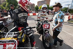 Jordan Graham (47) and Joe Kopp (3) get greeted by Roland Sands at the Revival and Roland Sands sponsored Super Hooligan races in the parking lot of the Austin American Statesman outside the Handbuilt Show. Austin, Texas USA. Saturday, April 13, 2019. Photography ©2019 Michael Lichter.
