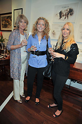 Left to right, JULIE AISBITT, GEORGIE AISBITT and LEXI AISBITT at a reception in aid of Save The Elephants held at Patrick Mavros, 104-106 Fulham Road, Lodon SW3 on 23rd September 2009.