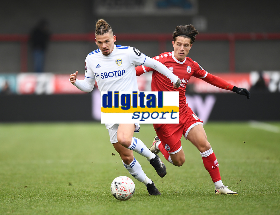 Football - 2020 / 2021 Emirates FA Cup - Round Three - Crawley Town v Leeds United - The People's Pension Stadium<br /> <br /> Leeds United's Kalvin Phillips holds off the challenge from Crawley Town's Tom Nichols.<br /> <br /> COLORSPORT/ASHLEY WESTERN