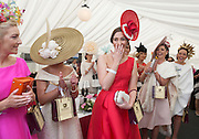 30/07/2015 Repro free  Ballybrit, Galway, Thursday 30th July 2015:  Cork native, Alex Butler (RED DRESS) from Ballyedmond, Midleton, Co .Cork has scooped the coveted title of Kilkenny Best Dressed Lady at the 2015 Galway Races Ladies Day, this year sponsored by the Kilkenny Group. photo:Andrew Downes