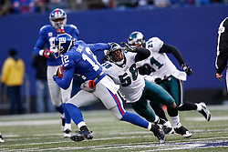 7 Dec 2008: Philadelphia Eagles linebacker Akeem Jordan #56 gets his arms around New York Giants wide receiver Steve Smith #12 during the game against the New York Giants on December 7th, 2008. The Eagles won 20-14 at Giants Stadium in East Rutherford, New Jersey. (Photo by Brian Garfinkel)