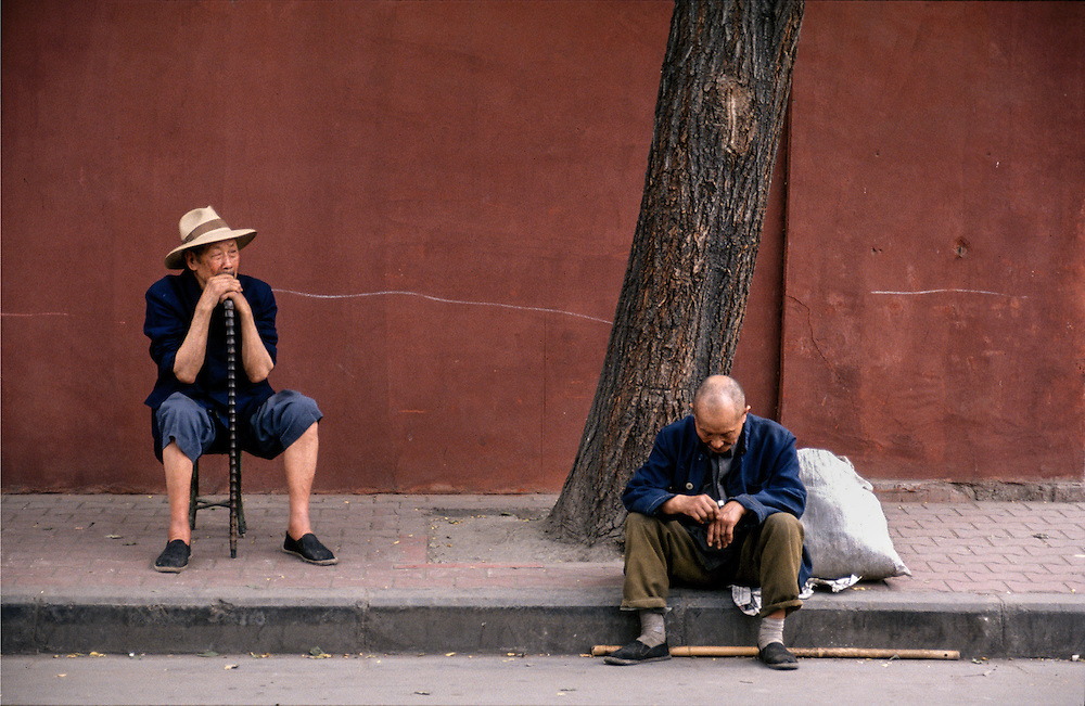 Men outside Wenshu Temple, Chengdu, China