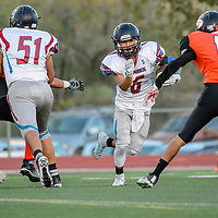 Shiprock Chieftain Quaid Shorty (6) rushes against the Gallup Bengals at Angelo DiPaolo Memorial Stadium in Gallup Friday.