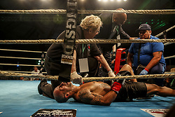 March 22, 2019 - Miami, Florida, USA - Argentina's ENRIQUE MARTIN ESCOBAR receives medical attention after suffering a knockout against Ismael Barros on the undercard of M&R Boxing Promotion's Fight Night at the Miccosukee Resort and Gaming Dome. (Credit Image: © Adam DelGiudice/ZUMA Wire)
