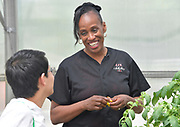 4-H ambassador Caleb Kinzinger, 16, from Freeburg, Ill and Jackie Joyner Kersee during a tour of the urban garden at the JJK Center on Thursday, May 30, 2019 in East St. Louis, Ill. (Tim Vizer/AP Images for National 4-H Council)