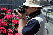 flower garden with man making pictures Japan