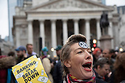 Climate change activists from Extinction Rebellion block the streets at Bank in the heart of the City of London financial district on 14th October 2019 in London, England, United Kingdom. Extinction Rebellion is a climate change group started in 2018 and has gained a huge following of people committed to peaceful protests. These protests are highlighting that the government is not doing enough to avoid catastrophic climate change and to demand the government take radical action to save the planet.