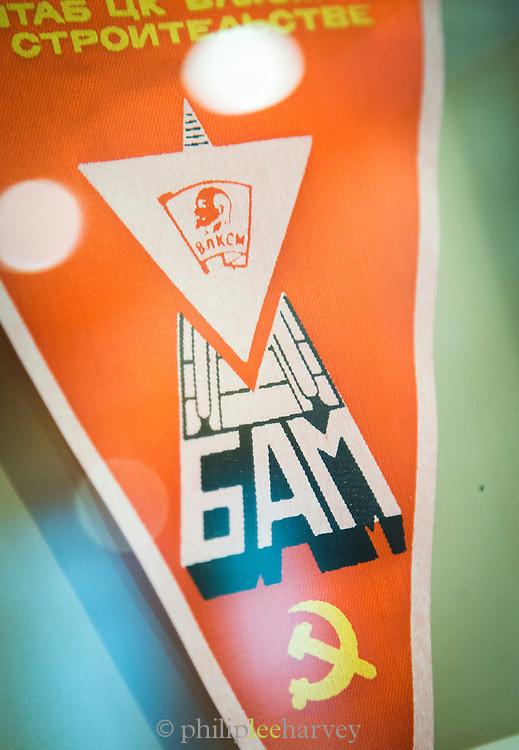 A banner celebrating the building of the BAM (Baikal-Amur Mainline) Railway.Tynda Museum. Tynda, Siberia.Russia