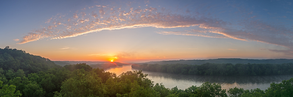 At 5am fog was slowly rising from the Rock River after an unseasonably cool night. Once the sun rose, it cast a warm glow across the river valley. This was taken at Castle Rock State Park, which sits on a 100 foot high bluff near Oregon, IL.<br /> <br /> Date Taken: July 11, 2014