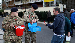Members of the Armed Forces collecting for the Poppy Appeal before the game