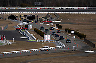 Cars enter as Lehigh Valley Health Network holds a COVID-19 mass vaccination clinic Mar. 20, 2021, at Pocono Raceway in Long Pond, Pennsylvania. Administrators were expected to vaccinate 3,000 people in the state of Pennsylvania's Phase 1A with the Moderna vaccine.