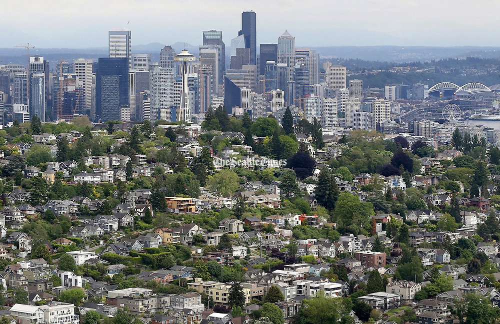 The Seattle skyline, looking southeast, with Queen Anne Hill in the foreground. (Greg Gilbert / The Seattle Times)