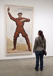 woman looking at painting The Orator by Ferdinand Hodler  in Neue Nationalgalerie in Kulturforum in Berlin Germany
