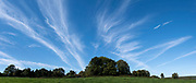 Beautiful Cirrus cloud formations above a green landscape on 27th September 2020 near Wyre Forest in Callow Hill, United Kingdom. Cirrus clouds are thin, wispy strands of cloud that form in streaks across the sky forming at very high altitudes.