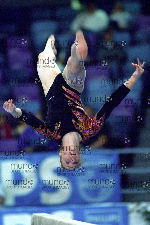 (Ottawa, Canada---16 May 1997) Veronique LeClerc competes in the balance beam at the 1997 Canadian Gymnastics Championships. Photograph copyright Sean Burges / Mundo Sport Images, 1997. www.mundosportimages.com