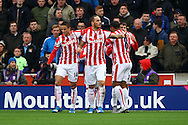Marko Arnautovic of Stoke City (c) celebrates with his teammates after scoring his teams 1st goal. Barclays Premier league match, Stoke city v Manchester city at the Britannia Stadium in Stoke on Trent, Staffs on Saturday 5th December 2015.<br /> pic by Chris Stading, Andrew Orchard sports photography.