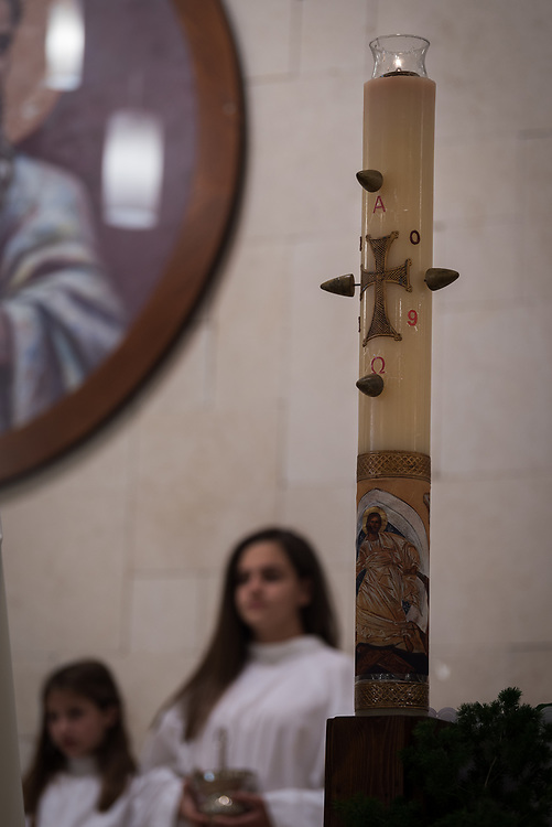 20 April 2019, Jerusalem: The candle burns, marked with the nails of the crucifixion of Christ, during Holy Saturday service at Saint James' Church in Beit Hanina, Jerusalem.