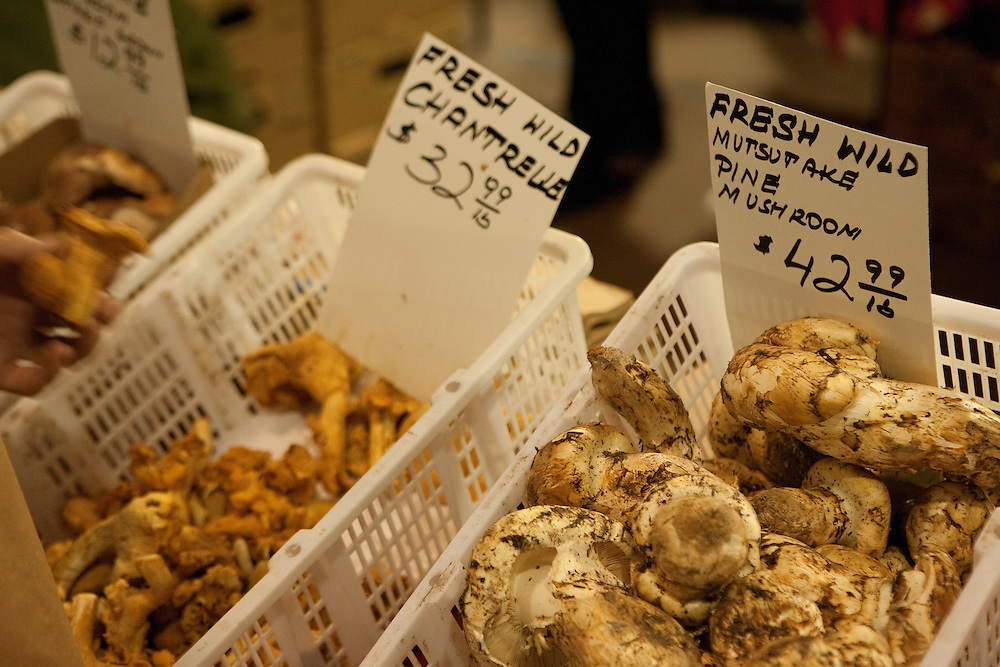 Baskets of matsutake and chanterelle mushrooms for sale at the Toronto St. Lawrence farmers' market.