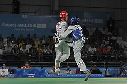 """October 9, 2018 - Buenos Aires, Buenos Aires, Argentina - T M.M. AMADOU of Nigeria and JOSE ACU""""A of Argentina compete during the Men'sTakewondo -55Kg Quaterfinals on Day 2 of the Buenos Aires 2018 Youth Olympic Games at the Olympic Park. (Credit Image: © Patricio Murphy/ZUMA Wire)"""