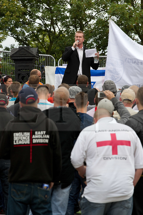 © Licensed to London News Pictures. 13/08/2011. Telford, UK. The EDL demonstrate against a paedophile ring in the small Telford town of Wellington. The group were going to march, however the Home Secretary imposed a ban on all marches in the area. About 300 EDL supporters attended. The EDL demonstration was counter-protested by about 300 people. Photo credit : Joel Goodman/LNP
