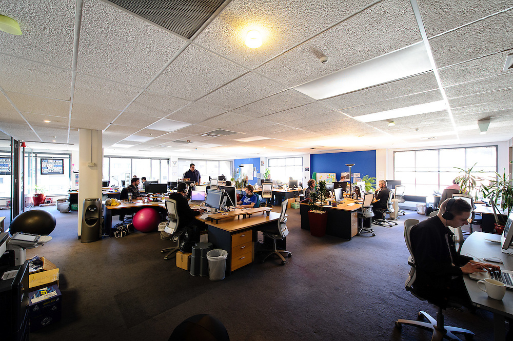 A wide view of the open plan office cubicles at Silverstripe's Wellington office. WELLINGTON, NEW ZEALAND - August 05:  Silverstripe profile: Tuesday 5 August 2014. August 05, 2014 in Wellington, New Zealand.  Silverstripe Business Profile.  (Photo by Mark Tantrum/ mark tantrum.com)