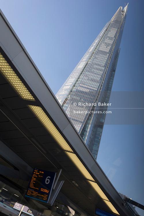The Shard tower rises high above platform 6 of London Bridge rail station, on 21st January 2020, in London, England.