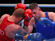 Luka Plantic of Croatia (left) and Umar Dzambekov of Austria compete in the Men's Light-heavyweight preliminaries during The Road to Tokyo European Olympic Boxing Qualification, Sunday, March 15, 2020, in London, United Kingdom. (Mitchell Gunn-ESPA-Images/Image of Sport)