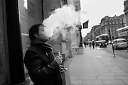Soanish man vaping outside the Institure of Directors, Pall Mall, London. 2 March 2016
