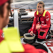 Leg 01, Alicante to Lisbon, day 01, Start on board MAPFRE. Sophie talking with Neti while she is fixing a winch. Photo by Ugo Fonolla/Volvo Ocean Race. 22 October, 2017